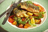 Mackerel fillets on a potato and tomato salad