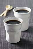 Black coffee into ceramic cups
