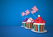 Three cupcakes decorated with USA flags on a blue surface (illustration)