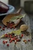 An arrangement of allspice, peppercorn, bay leaves, nutmeg and cloves