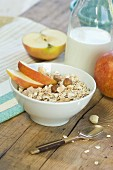 A healthy breakfast: muesli with apple, nuts and milk