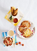 Various children's dishes: mini pizzas, pasta with tomatoes and chicken nuggets