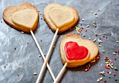 Heart-shaped shortbread biscuits on sticks