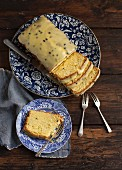 Passion fruit cake with a sugar glaze with a slice on a plate