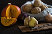 Ingredients for pumpkin soup with potatoes and onions