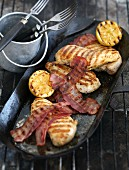 Grilled chicken breast with lemons and bacon