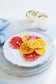 Citrus salad with pink grapefruit, oranges, nuts and yoghurt
