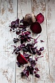 Fresh beetroot and beetroot leaves on a wooden surface