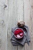 Pickled beetroot in a preserving jar (seen from above)