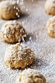 Icing sugar being sprinkled over oat bites