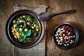 Vegan spinach soup with chickpeas, kidney beans and lentils (Arabia)