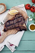 Grilled T-Bone steak on a chopping board