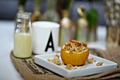 Stuffed baked apple with crumbles