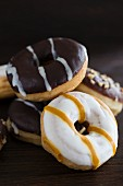 Doughnuts with various glazes on a wooden surface