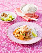 Tandoori fish with leek and carrots on a bed of rice