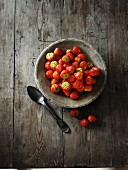 Strawberries in a grey ceramic bowl