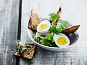 Aubergine salad with egg and grilled bread