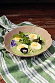 Eggs in Frankfurt green sauce garnished with flowers