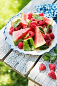 A summer red fruit salad with watermelon, raspberries and mint
