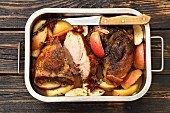 Pork shoulder baked with apples, cinnamon and star anise