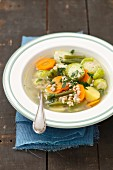 Vegetable soup with Brussels sprouts, green beans, carrots, potatoes and barley
