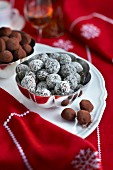 Truffle pralines with coconut and cocoa powder for Christmas