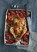 Stuffed roast chicken on a pepper and onion medley