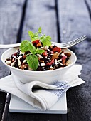 Red rice salad with feta cheese and almonds