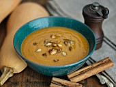 Butternut squash soup with cinnamon and pumpkin seeds