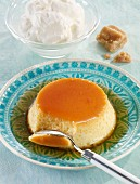 Flan with caramel sauce and whipped cream