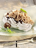 Chestnut cream vermicelli on meringue