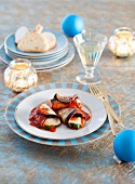 Aubergine rolls with mozzarella and tomato sauce for Christmas