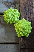 Romanesco broccoli on a wooden crate (seen from above)