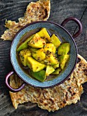 Pickled mango served with chapatis