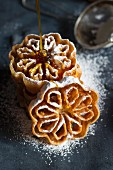 Swedish rose shaped waffles with honey and icing sugar