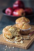 Apple and cinnamon muffins on a chopping board