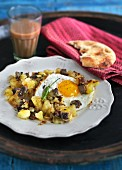Beef with potatoes and fried egg (India)