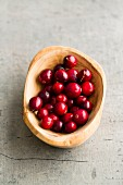 Cranberries in a wooden bowl (seen from above)