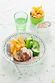 Veal meatballs in Madeira sauce with chips and broccoli