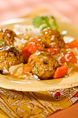 Turkey meat balls in a vegetable sauce on a bed of rice