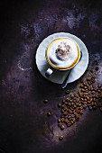 Cappuccino cup and saucer, coffee beans