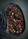 Venison in a red wine sauce with chestnuts and vegetables