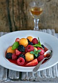 Colourful fruit and berry salad