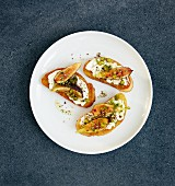 Crostini topped with ricotta, limes, Szechuan pepper, figs, rosemary honey and pistachio nuts