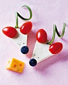 Cheese mice with cherry tomato ears and blueberry noses
