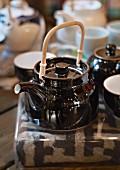 Various teapots and tea bowls