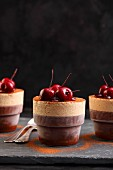 Iced chocolate and peppers soufflés with cherries