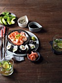 A plate of sushi and prawns served with a cucumber mojito with coriander and Ginger