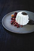 Panna cotta with chia seeds, pomegranate and raspberries