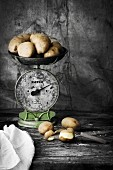Potatoes on an old pair of kitchen scales
